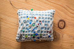 Sewing cushion with colored pins Stock Photo