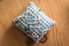 Sewing cushion with colored pins Royalty Free Stock Images