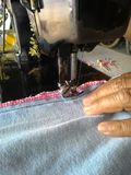 Sewing denim Stock Photo
