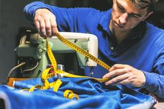 Sewing denim jeans with sewing machine. Repair jeans by sewing machine. Alteration jeans, hemming a pair of jeans, handmade royalty free stock photos