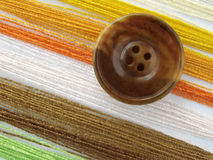 Sewing design 1. Button with colorful sewing threads Stock Photography