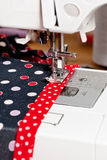 Sewing dress on machine Stock Images