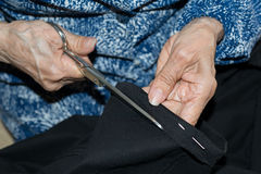 Sewing elderly person Stock Photography