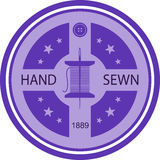 Sewing emblem Royalty Free Stock Image