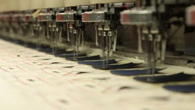 Sewing & embroidery machine in slow-motion stock footage