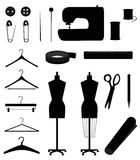 Sewing equipment. Isolated pins, sewing machine, buttons, pencil, mannekens, hangers, measure tape, measure line, spools, needle, scissors and fabric Stock Images