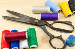 Sewing equipment chaos on the table Royalty Free Stock Photos