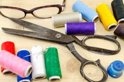 Sewing equipment chaos on the table Stock Image