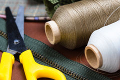 Sewing equipment. Closeup thread spools on sewing desk Royalty Free Stock Photography
