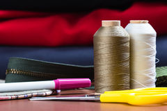 Sewing equipment. Closeup  thread spools and sewing equipments Stock Photography