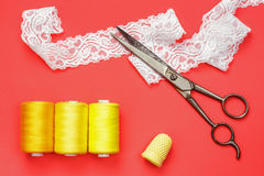 Sewing equipment on red background Royalty Free Stock Photos