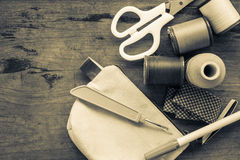 Sewing equipment. On wood table, vintage style Royalty Free Stock Photos