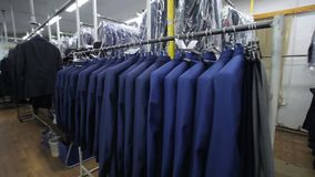 Sewing factory. Clothing industry. Sewing of outer clothing. stock video