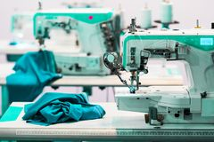 Sewing factory, nobody, overlock machines. Sewing factory, nobody, overlock, stitching machines. Clothing sew Textile fabric and cloth manufacturing Stock Images