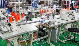 Sewing factory, nobody, overlock machines. Sewing factory, nobody, overlock, stitching machines. Clothing sew Textile fabric and cloth manufacturing Stock Photo