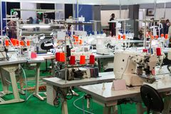 Sewing factory, nobody, overlock machines. Sewing factory, nobody, overlock, stitching machines. Clothing sew Textile fabric and cloth manufacturing Royalty Free Stock Photo