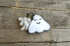 Sewing felt Halloween ghost decor. Join the felt edges of the toy using a blanket stitch and stuff with hollowfiber. Step Royalty Free Stock Photos