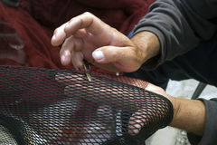 Sewing fishing net Stock Image