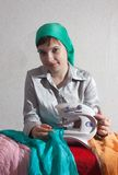 Sewing girl royalty free stock image