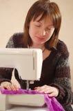 Sewing girl Royalty Free Stock Photos