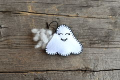 Sewing Halloween ghost decor. Join the felt edges of the toy using a blanket stitch and stuff with hollowfiber. Step Royalty Free Stock Images