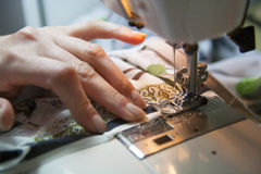 Sewing by hand Stock Photos