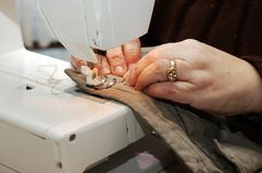Sewing hands. Stock Images