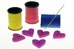 Sewing with Heart Shaped Buttons Royalty Free Stock Images