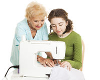 Sewing Help from Grandma royalty free stock image