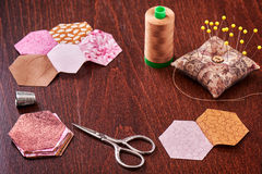 Sewing of hexagon pieces of fabric a quilt Grandmother`s Flower Garden Royalty Free Stock Photo
