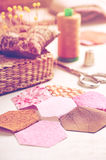 Sewing of hexagon pieces of fabric a quilt Grandmother`s Flower Stock Photography