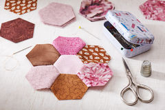 Sewing of hexagon pieces of fabric a quilt Grandmother`s Flower Garden Royalty Free Stock Photography