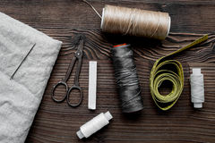 Sewing hobby with tools, thread, scissors wooden background top view Stock Images