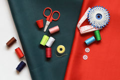 Sewing Item. Sewing set lying on various colored cloth royalty free stock photos
