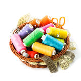 Sewing items. In basket: threads, pins, meter and scissors on white royalty free stock photos