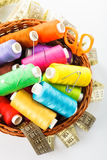 Sewing items. In basket: threads, pins, meter and scissors on white royalty free stock photo