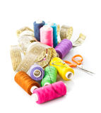Sewing items. Multicoloured threads, pins, meter and scissors on white royalty free stock photo