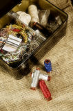 Sewing items. In a box photographed on a beige textile stock images