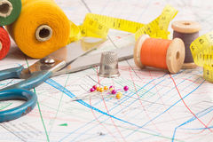 Sewing items background. With old scissors, thread spools and tape measure Stock Images