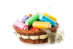 Sewing items. In basket: threads, pins, meter and scissors on white stock photo