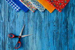 Sewing items on blue table stock photos