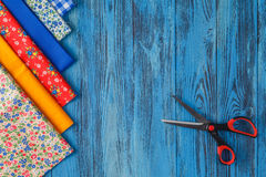 Sewing items on blue table stock image