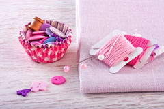 Sewing items with a check fabrics, buttons, thread Royalty Free Stock Photography