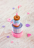 Sewing items with a check fabrics, buttons, thread Royalty Free Stock Photos
