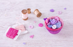 Sewing items with a check fabrics, buttons, thread and pins Stock Photo