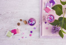 Sewing items with a check fabrics, buttons, thread and pins Stock Photography