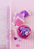 Sewing items with a check fabrics, buttons, thread and pins Royalty Free Stock Photo