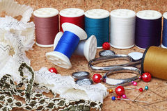 Sewing items. On cork board royalty free stock photography