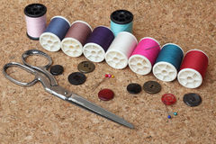 Sewing items. On cork board royalty free stock photos