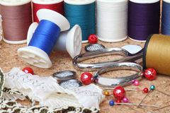 Sewing items. On cork board stock images